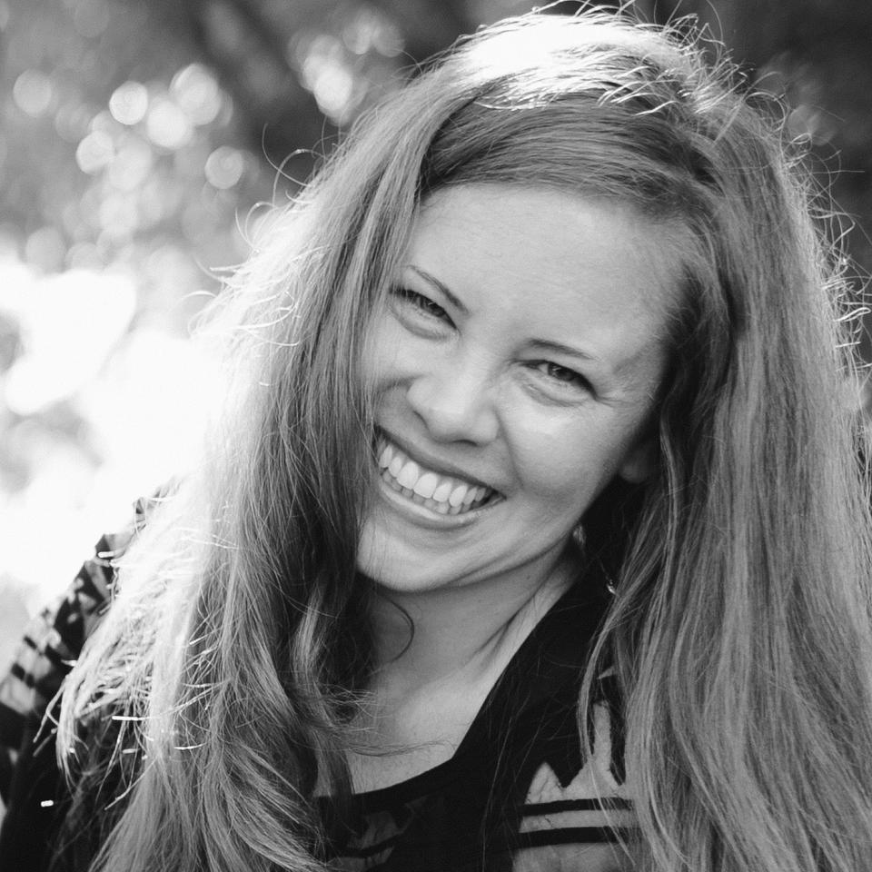 black and white photo of luna crow smiling: white skinned woman with long hair outside