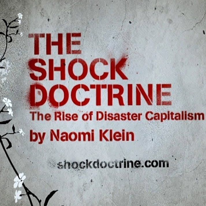 red stencil on gray: Shock Doctrine by Naomi Klein