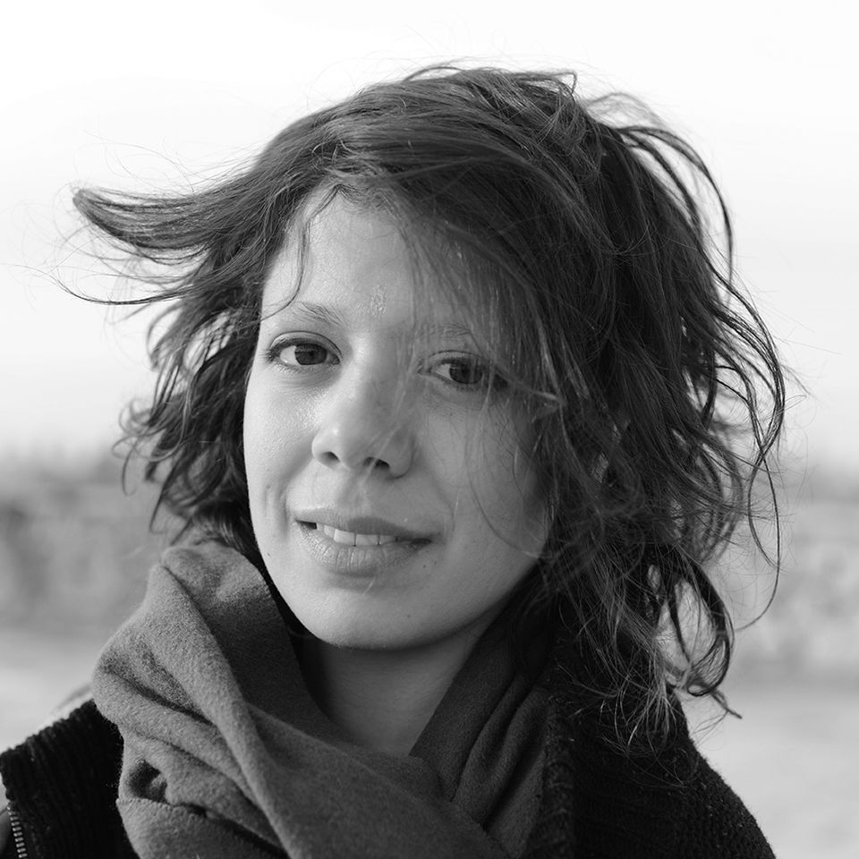 black and white photo of cassandra, a lighter skinned person with chin length hair