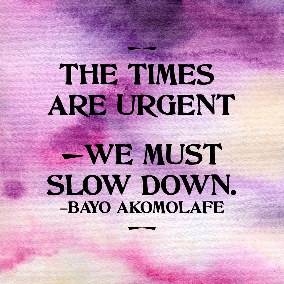 "Quote: ""The times are urgent, we must slow down - Bayo Akomolafe"" over purple watercolor"
