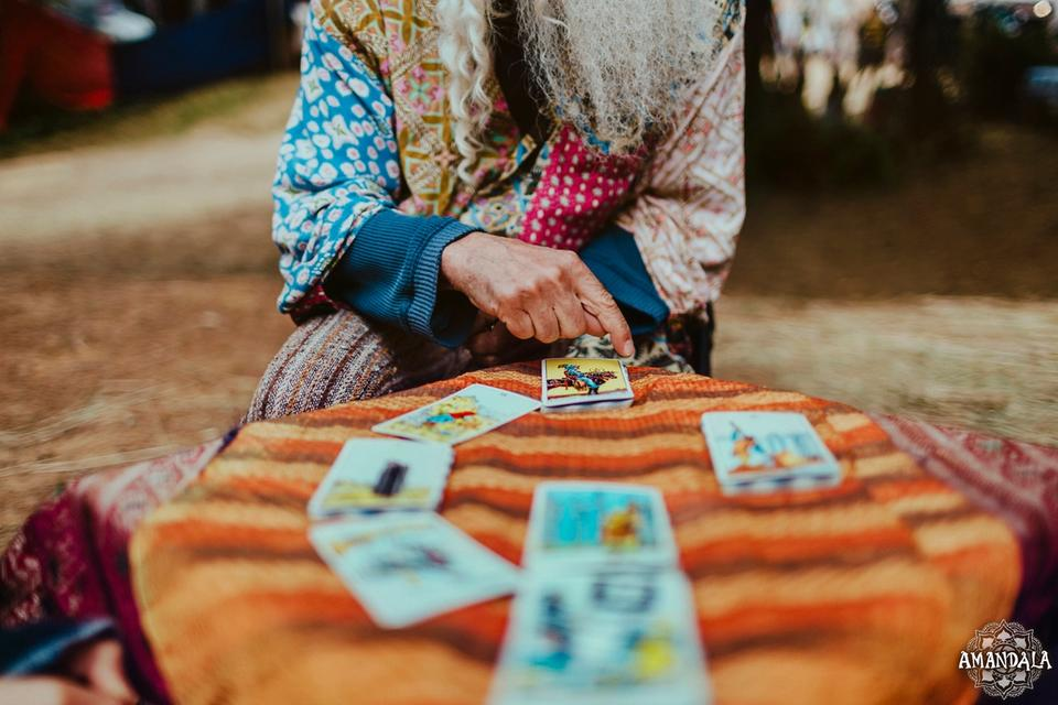 a tarot reader and their cards